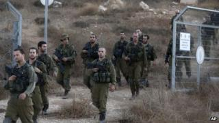 Israeli soldiers are seen after searching for the remains of a drone in the Negev southern Israel