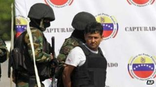 Martin Llanos escorted by Venezuelan soldiers in February 2012