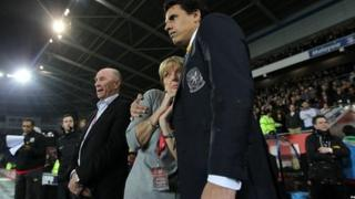 Gary Speed's father Roger and mother Carol with Wales manager Chris Coleman (right) during the International Friendly at Cardiff City Stadium, Cardiff in February. Pic: David Davies/PA Wire