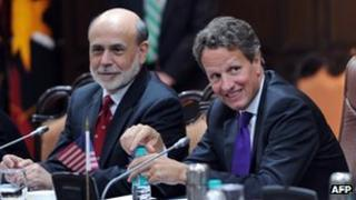 US Treasury Secretary Timothy Geithner (R) talks with US Federal Reserve Chairman Ben Bernanke during a meeting of US-India Economic and Financial partnership with India Finance Minister P. Chidambaram in New Delhi on October 9, 2012.