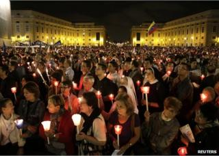 Catholics attend a candlelight procession to mark the 50th anniversary of Vatican II at the Vatican, 11 October