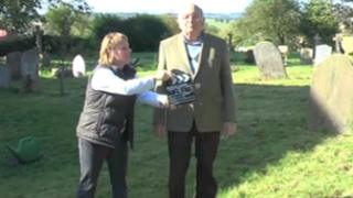 Filming the video in the churchyard