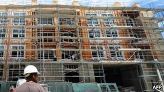 Construction worker in front of block of flats being built in Los Angeles