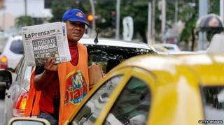 Newspaper vendor in Panama