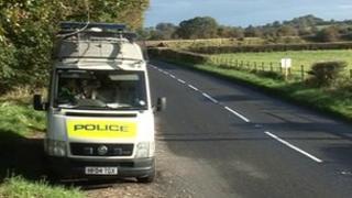Police van on country road
