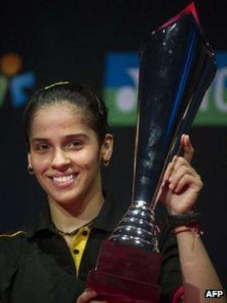 Saina Nehwal with the winner's trophy in Denmark on 21 Oct 2012