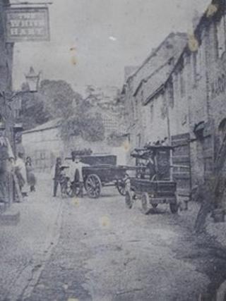 Vintage fire pump being used in Church Street, Ledbury, in 1890
