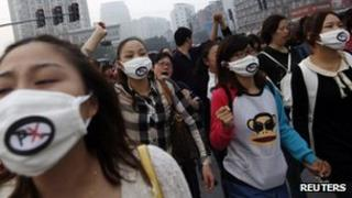 People chant slogans as they march during a protest against plans to expand a petrochemical plant in Ningbo, China, 28 Oct 2012