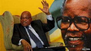 South African President Jacob Zuma sitting in front of a portrait of late African National Congress (ANC) President Oliver Reginald Tambo, during a briefing with the South African Foreign Correspondents Association in Johannesburg - 29 October 2012