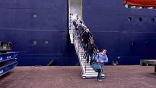 Workers arrive ashore