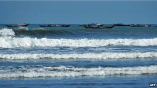 Boats on the Bay of Bengal carry Rohingya away from the violence