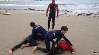 Lifeguards practicing first aid