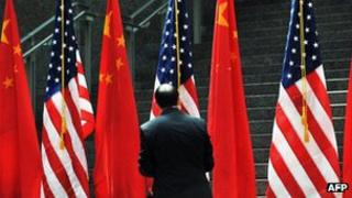 An official adjusting US and China flags