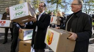 Philippe Roch, right, helps hand in the petition to Swiss Chancellery in Bern