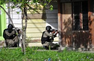 Indonesian anti-terror police take aim in Poso, Central Sulawesi province, 3 November