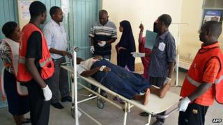 An injured man is brought to Garissa district hospital following the grenade attack on a police church on 4/11/12