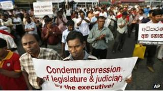 Opposition lawmakers and rights activists participate in a protest against the government in Colombo