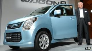 Chairman of Japanese automaker Suzuki Motor, Osamu Suzuki introduces the company's new compact car
