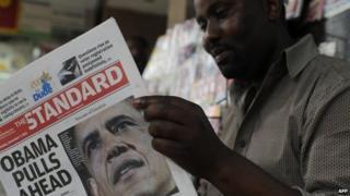 A Kenyan reading a newspaper in Nairobi on Wednesday 7 November 2012