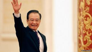 Wen Jiabao waves as he arrives for a news conference following the close of China's National People's Congress (NPC) at The Great Hall Of The People in Beijing, 14 Mar 2012