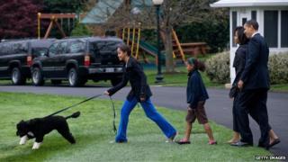 Obama family with dog