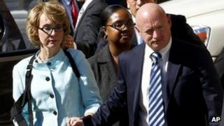 Gabrielle Giffords and Mark Kelly as they walk out of court after the sentencing of Jared Loughner Tucson, Arizona 8 November 2012