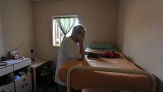 Prisoner reading in cell