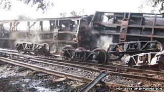 Wrecked train carriages in Burma, 9 November