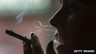 Person smoking a cannabis cigarette