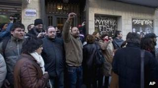 Demonstrators against evictions block the door to a house in Madrid