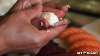 chef making sushi dish