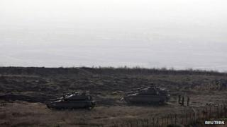 File pic: Israeli tanks are seen close to the ceasefire line between Israel and Syria, near Alonei Habashan in the Israeli-occupied Golan Heights, 7 November 2012