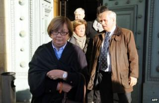 Members of the De Vedrines family leave court in Bordeaux, south-west France, 13 November
