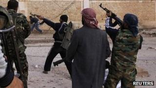 Free Syrian Army fighters firing weapons