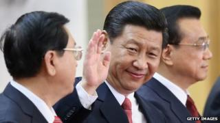 Members of the new Politburo Standing Committee Xi Jinping (C), Li Keqiang (R) and Zhang Dejiang (L) greet the media at the Great Hall of the People on November 15, 2012 in Beijing, China.