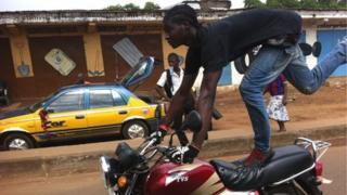 A supporter of Sierra Leone President Ernest Bai Koroma