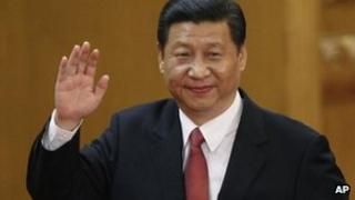 New Communist Party General Secretary Xi Jinping waves in Beijing's Great Hall of the People, 15 Nov 2012