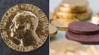A Nobel Prize medal and some chocolate coins