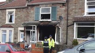 Police Community Support Officers outside a house in Cossham, Bristol