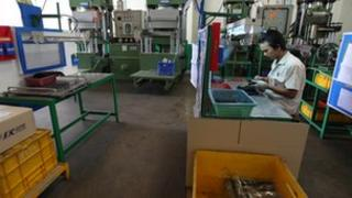 Worker in a rubber factory
