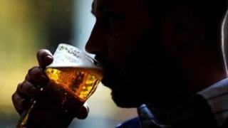 Man drinks pint of lager