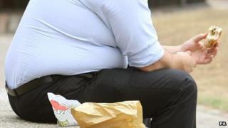An overweight man eating