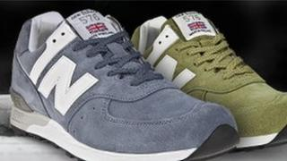 New Balance training shoes with small union jacks attached