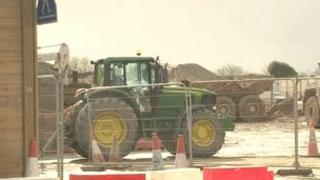 Lagan tractor used to move material from Longue Hougue to Guernsey Airport