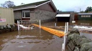 Flood water around a house in Comrie