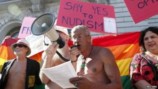 Nudists hold a rally in front of San Francisco city hall