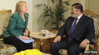 US Secretary of State Hillary Clinton and Egyptian President Mohammed Mursi in Cairo. 21 Nov 2012