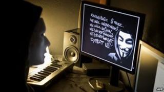 Masked hacker in France (file photo)