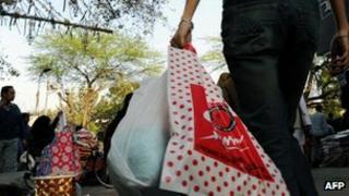 A shopper in Delhi carrying plastic bags