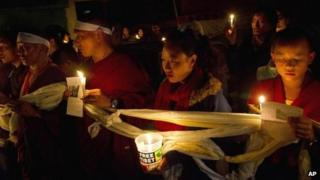 Tibetan exiles participate in a candlelit vigil in solidarity in Dharmsala, India, after reports of a self-immolation in northwestern China's Gansu province, 13 Oct 2012